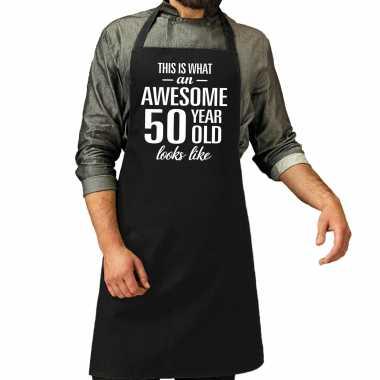 Awesome 50 year / 50 jaar cadeau bbq / keuken schort zwart heren